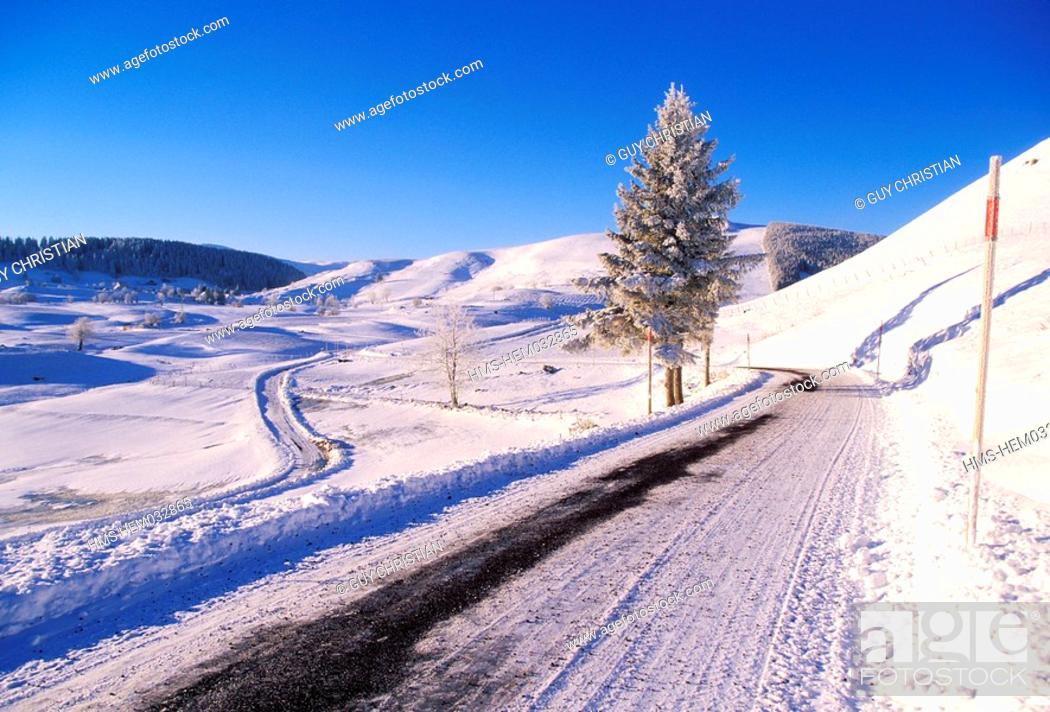 Stock Photo: France, Puy de Dome, Cezallier plateau, snow covered road close to Boutaresse village.
