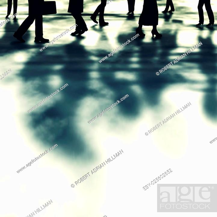 Stock Vector: Editable vector illustration of people and their shadows walking along a street made using a gradient mesh.