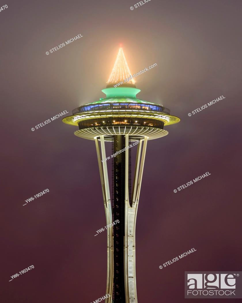 Stock Photo: Space Needle lighting low cloud at night, Seattle, Washington, USA.