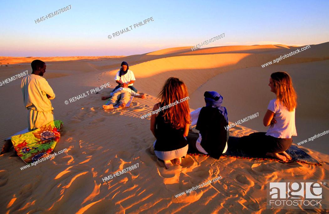 Stock Photo: Mauritania, Adrar region, hike in the desert, practice of Shiatsu at nightfall.