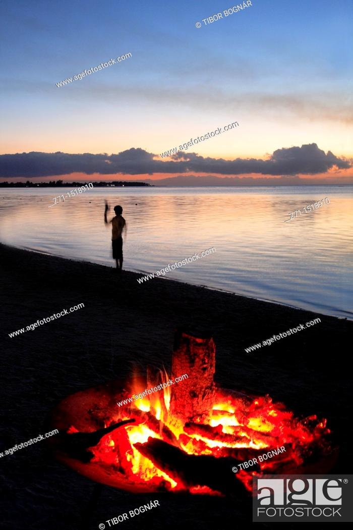 Stock Photo: Campfire on beach at sunset, Trou aux Biches, Mauritius.