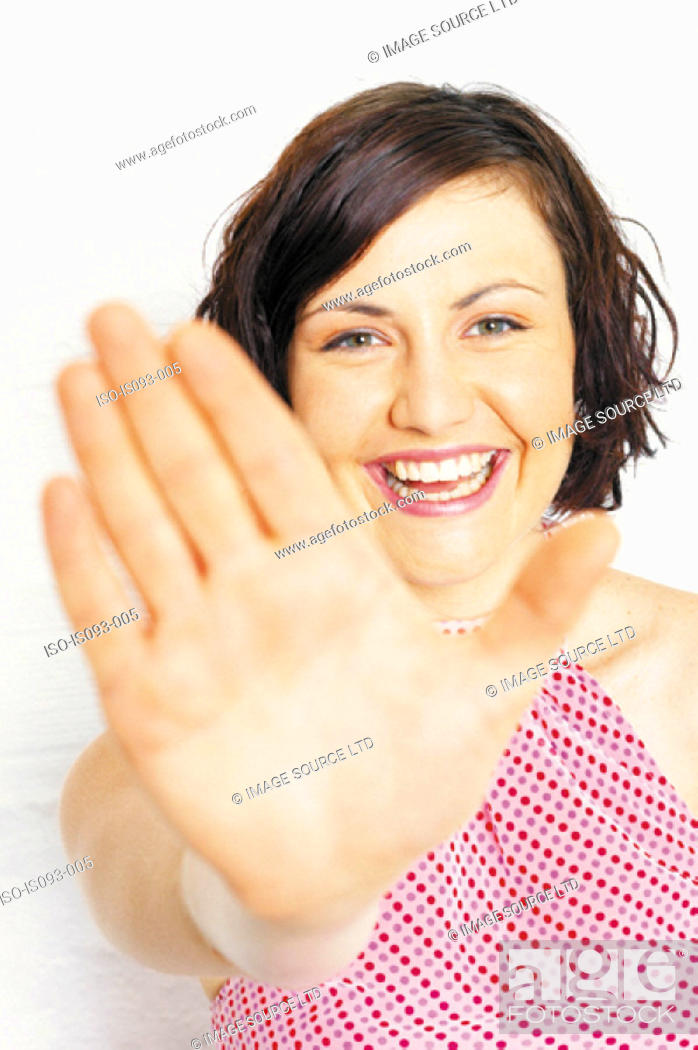 Stock Photo: Woman holding out hand.