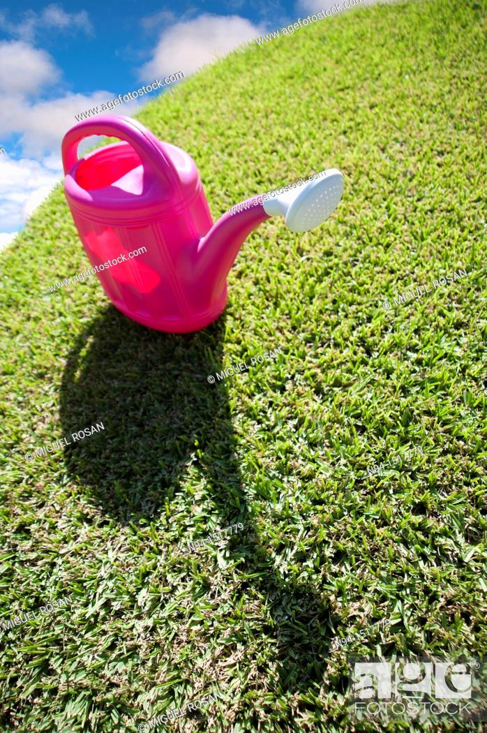 Stock Photo: Plastic watering can.