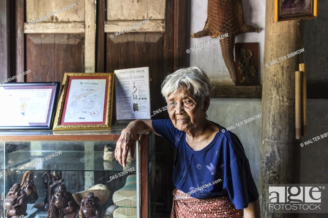 Stock Photo: Cambodia, Battambang, Wat Kor Village, Khor Sang House, older Cambodian woman, owner of traditional Khmer wood house built by her grandfather, NR.