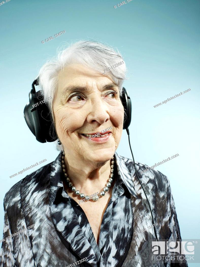 Stock Photo: A senior woman wearing headphones.