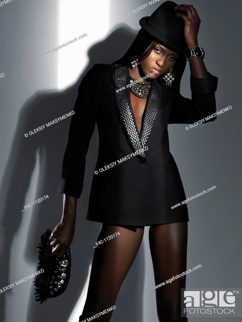 Stock Photo: Woman in sexy black outfit High fashion photo.