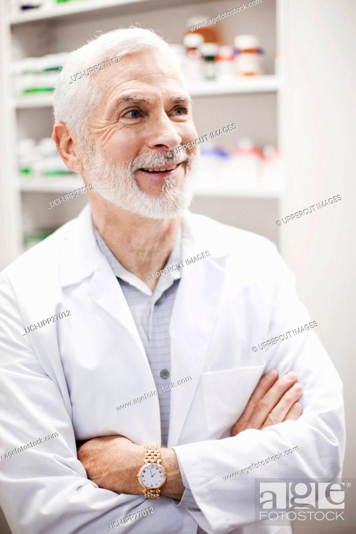 Stock Photo: Close up of pharmacist with arms crossed.