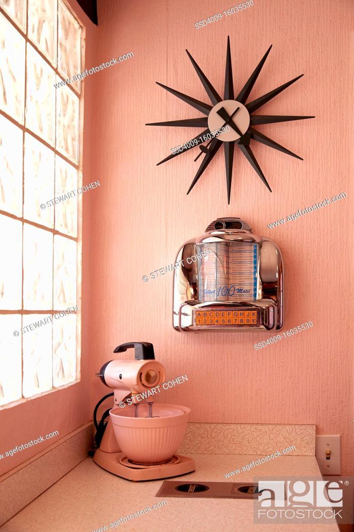Stock Photo: Vintage kitchen with pink appliances.