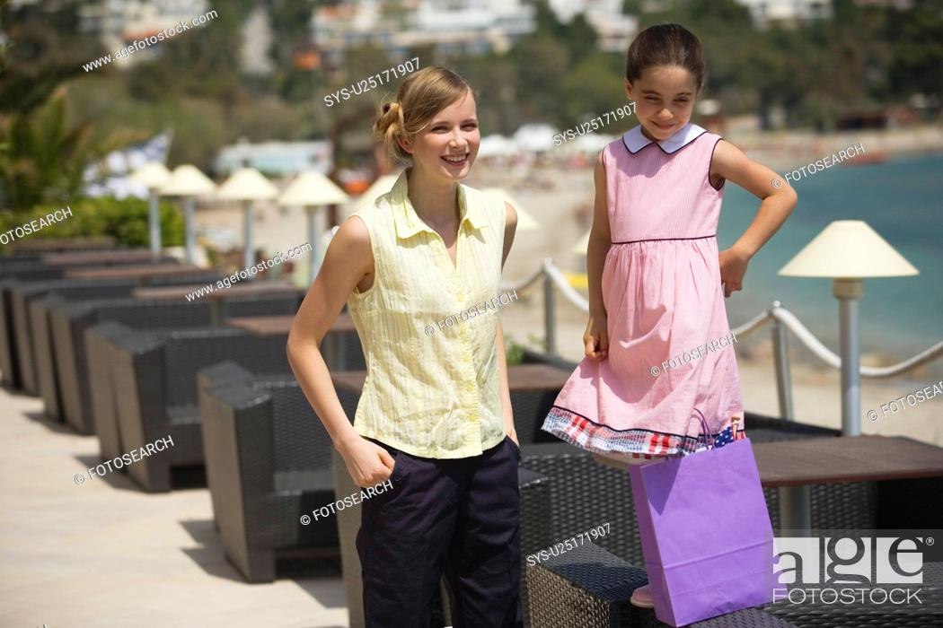 Stock Photo: Mother and daughter with shopping bag.