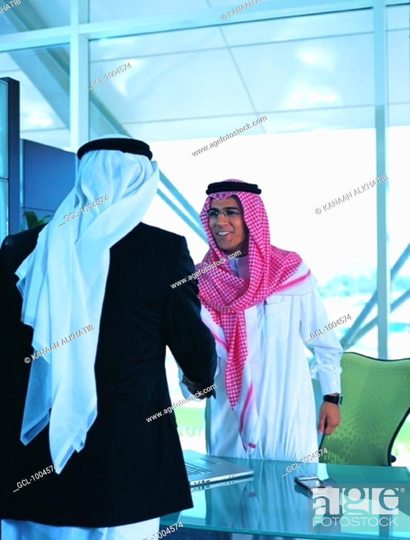 Stock Photo: Saudi Arabian businesspeople shaking hands.