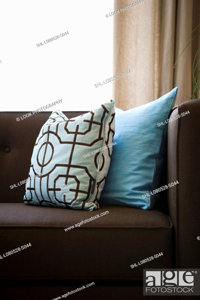 Detail Blue Throw Pillows On Chocolate Brown Sofa Stock Photo Picture And Rights Managed Image Pic Shl L080528 S044 Agefotostock