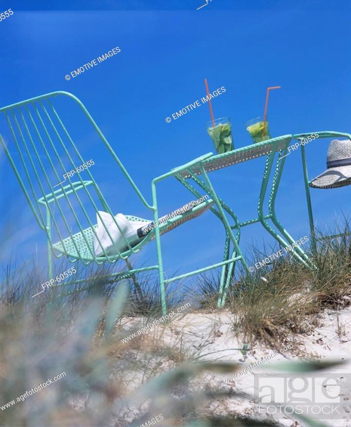 Stock Photo: On the beach: a place with two caipirinhas.