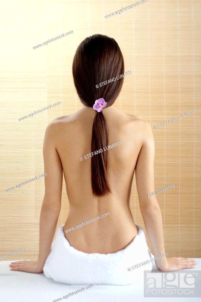 Stock Photo: Rear view of a beautiful woman at spa.