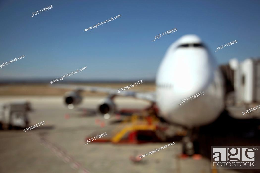 Stock Photo: Jumbo jet attached to boarding bridge.