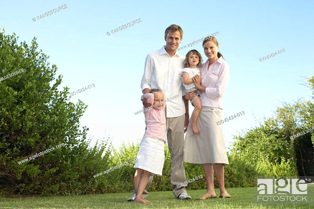 Stock Photo: Portrait of a family in the garden.