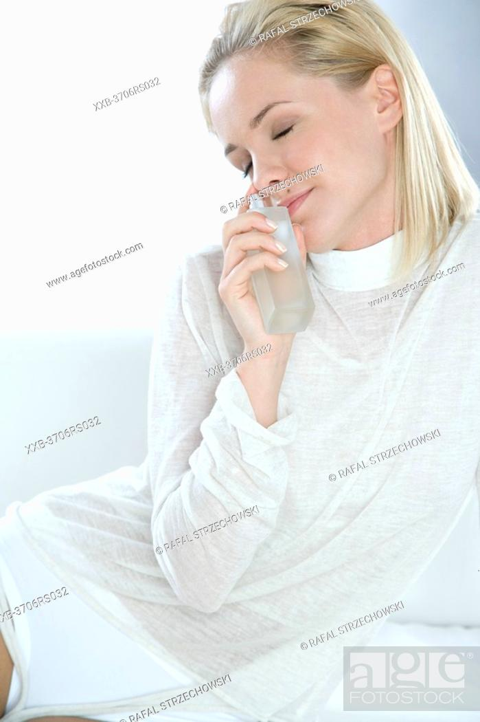 Stock Photo: young woman with perfume.