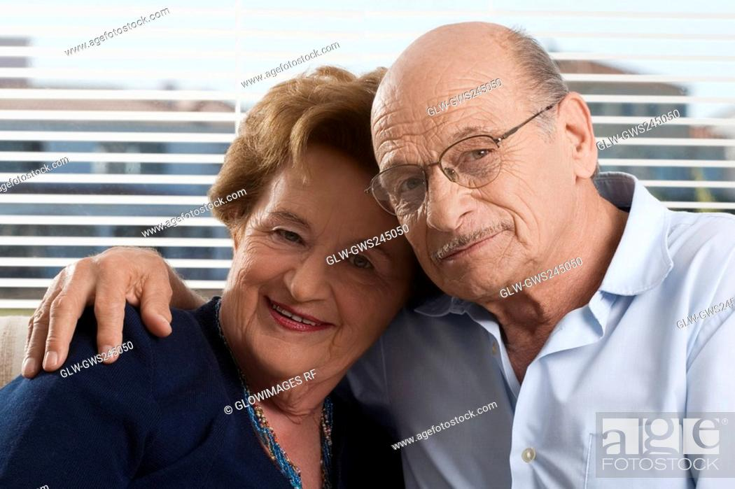 Stock Photo: Portrait of a senior couple sitting together.