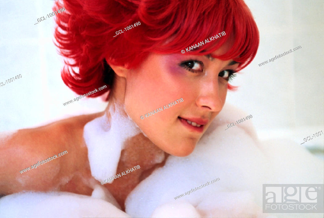 Stock Photo: Woman with red hair having a bath.