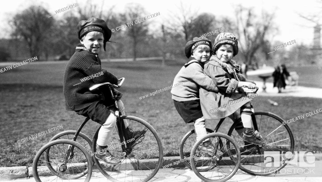 Stock Photo: children riding bicycles in a park.