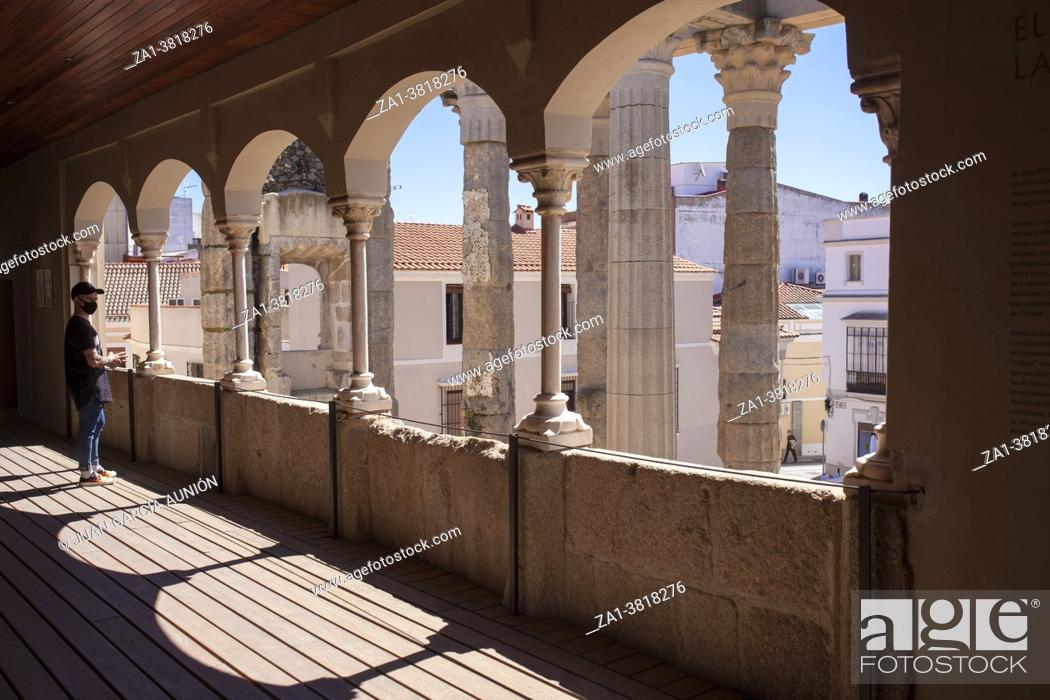 Stock Photo: Merida, Spain - April 17th, 2021: Visitor at Temple of Diana Interpretation Centre, Merida, Extremadura, Spain. Best-preserved Roman temple in Spain.