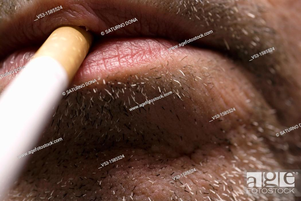 Stock Photo: Man with cigarette in mouth.