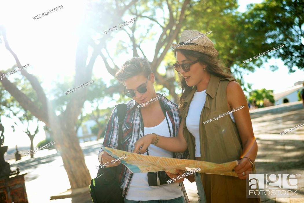 Photo de stock: Young couple looking at city map.