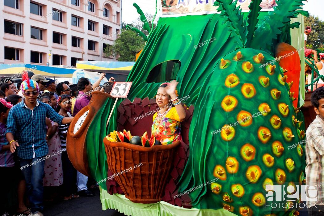 Stock Photo: People at traditional procession in a carnival, Goa Carnivals, Goa, India.