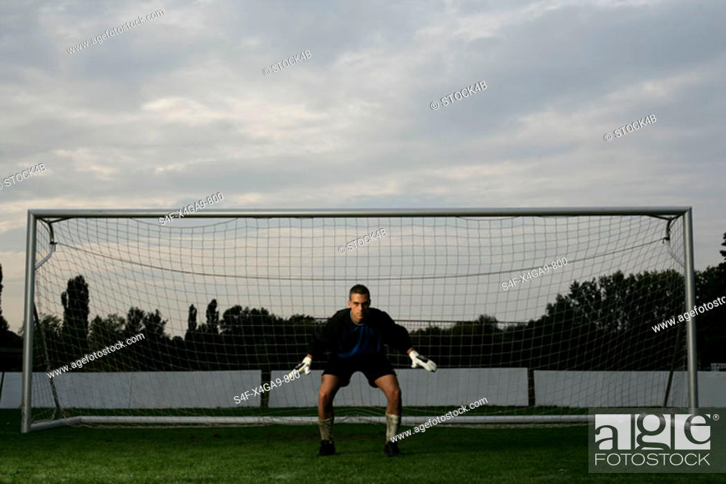 Stock Photo: Goalkeeper standing in a goal.