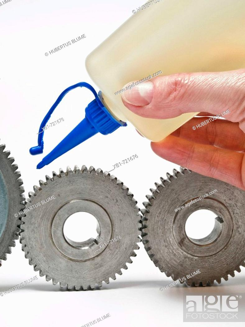 Stock Photo: some old gear wheel greasing with a oilcan.