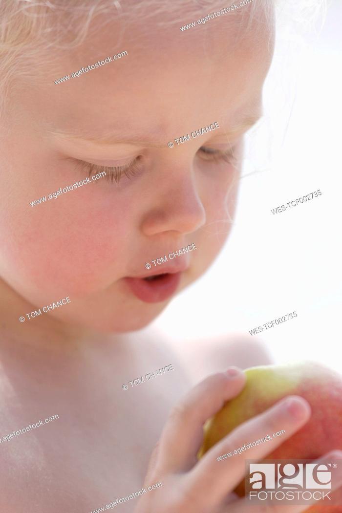 Stock Photo: Germany, Bavaria, Girl eating apple, close up.