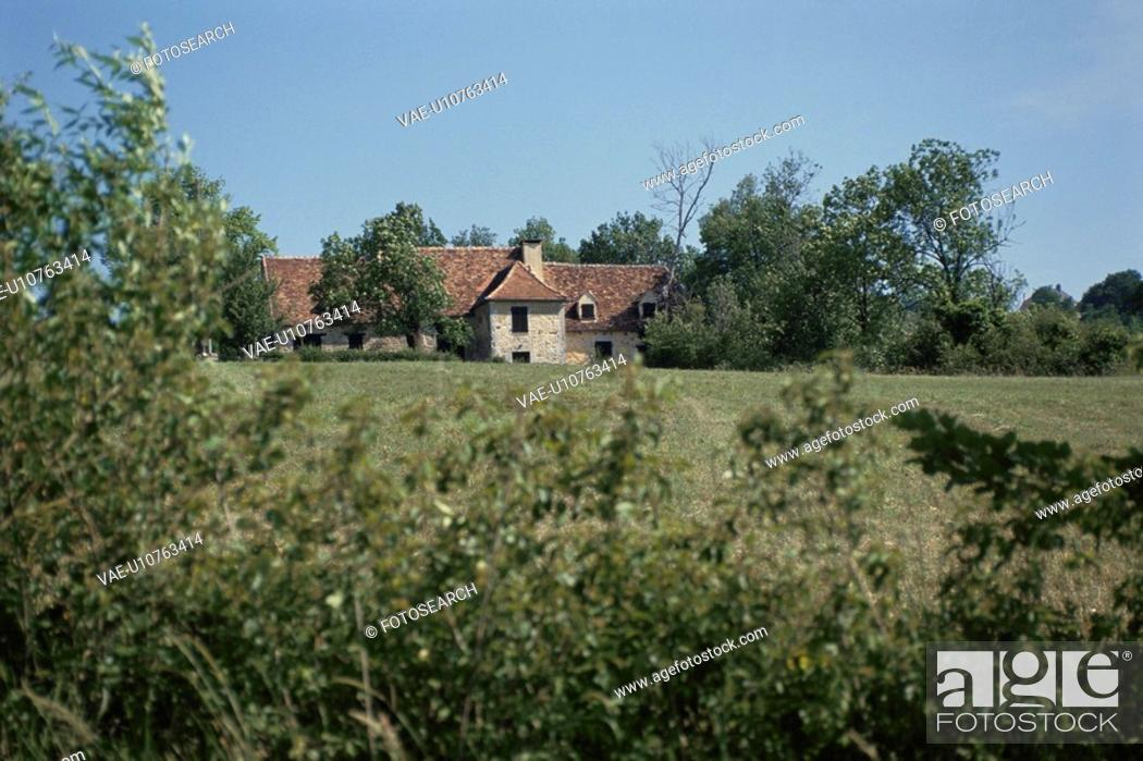 Stock Photo: The House With The Red Brick Roof And The Forest In France.