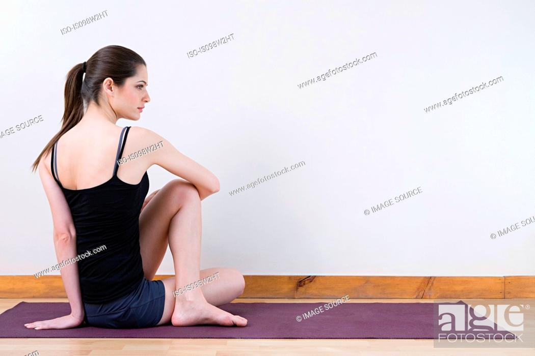 Stock Photo: Woman stretching during yoga.