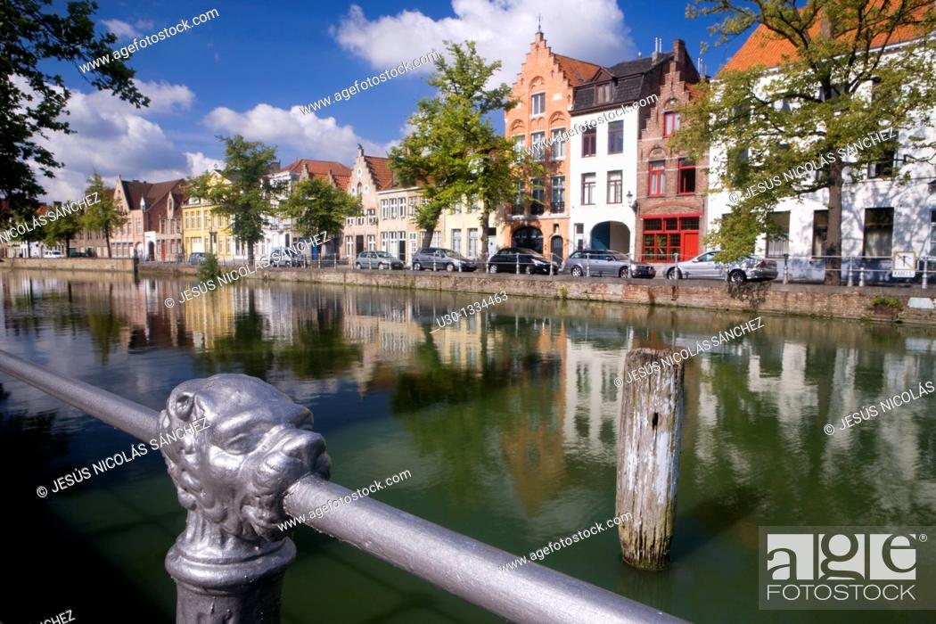Stock Photo: Typical canal in the medieval town of Brugge, listed World Heritage Site by UNESCO  Flanders  Belgium.