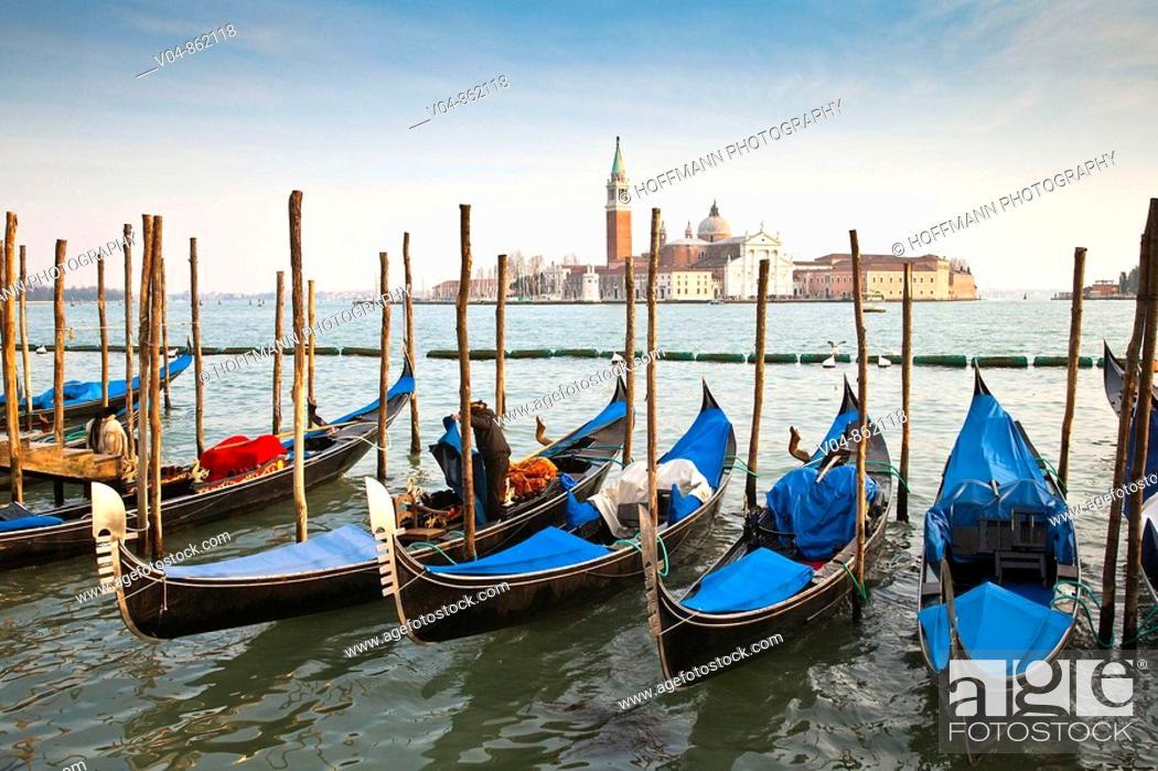 Stock Photo: Several gondolas moored in front of San Giorgio Maggiore in Venice, Italy, Europe.