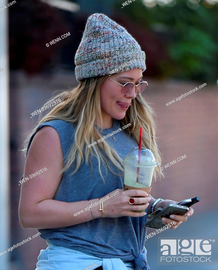 a4fb0cc49bb Stock Photo  Hilary Duff grabs a juice wearing a beanie cap following a  workout.