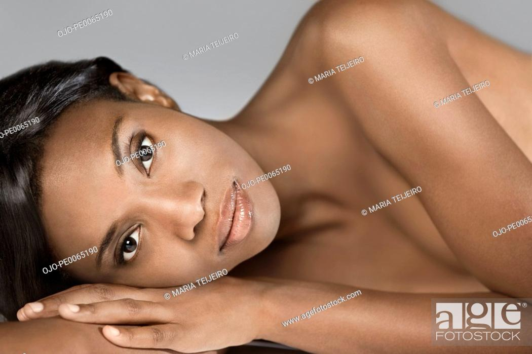 Stock Photo: Nude African woman laying on side.