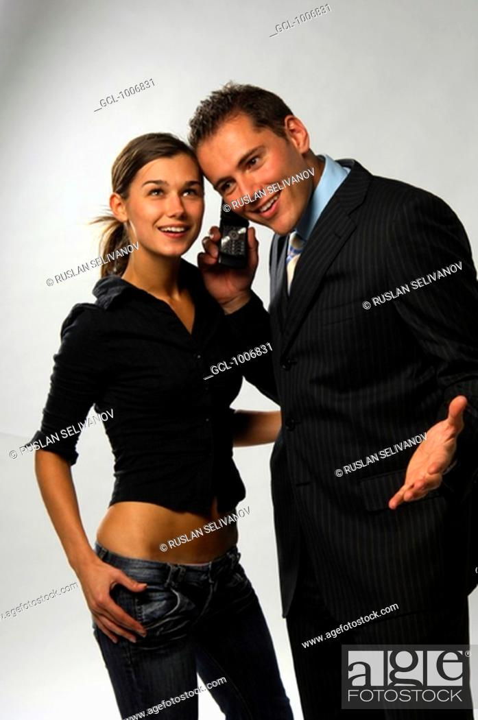 Stock Photo: Smiling couple using mobile phone.