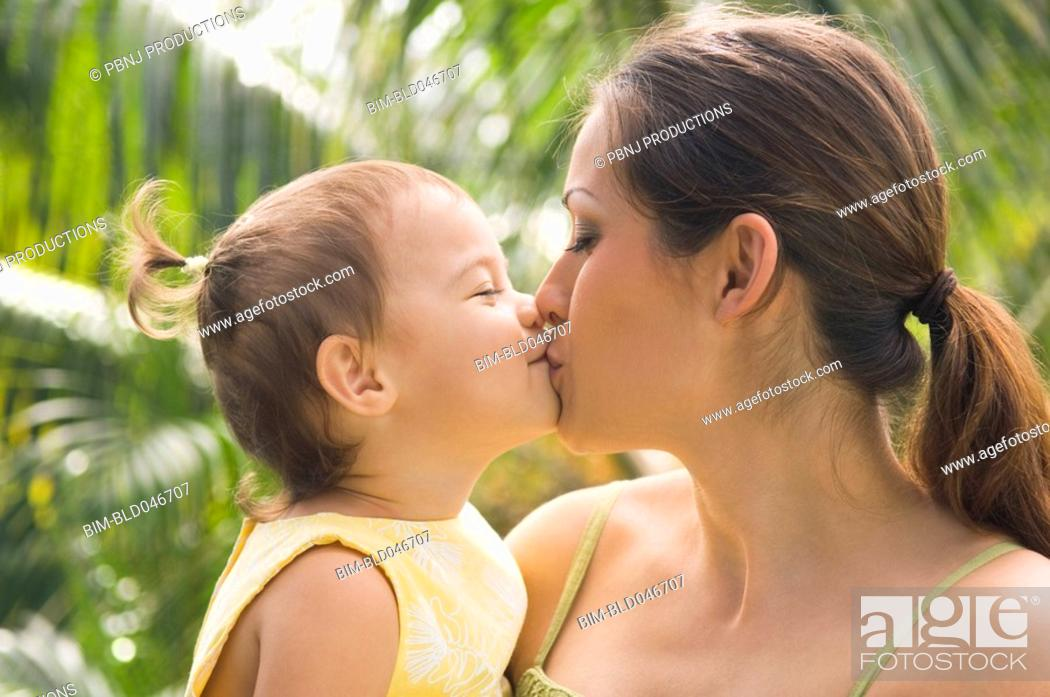 Stock Photo: Hispanic mother kissing baby.