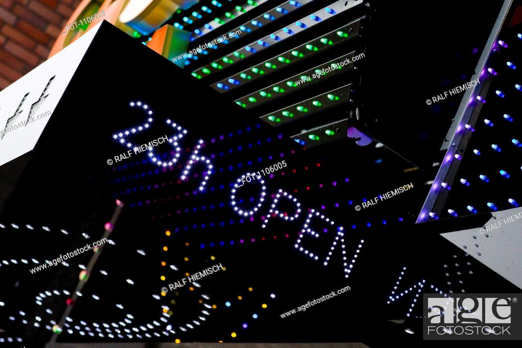 Stock Photo: An illuminated 23h OPEN sign on the outside of a building.