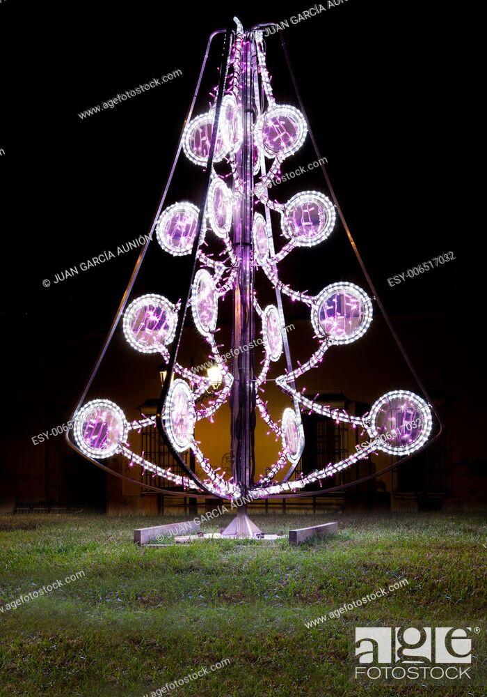 Imagen: Led Christmas tree placed on park grassland area.