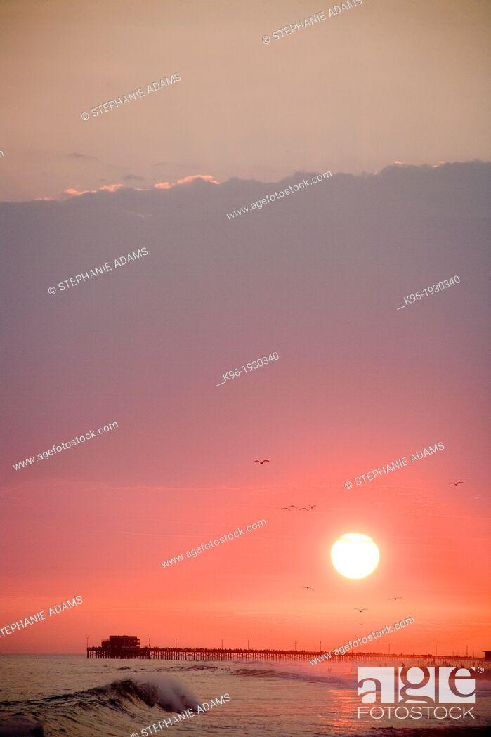 Stock Photo: sun setting over Newport Beach California.