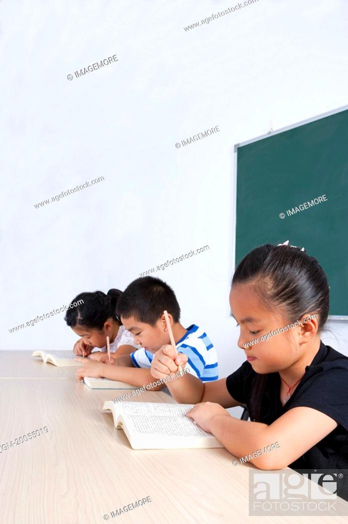 Stock Photo: Child, Children sitting and studying in the classroom.
