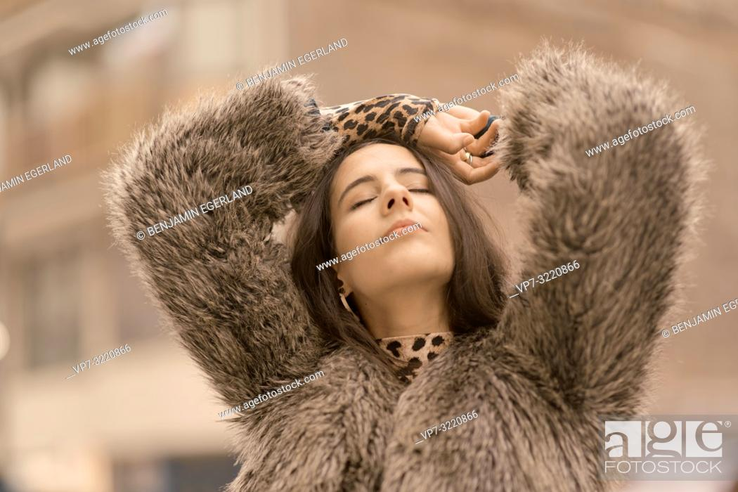 Stock Photo: portrait of young sensual woman with closed eyes at street in city, relaxed mood, in Munich, Germany.