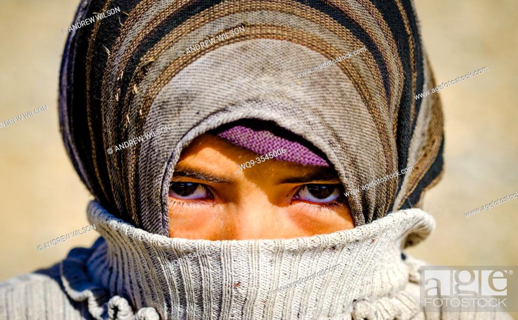 Stock Photo: Portrait of a young nomadic woman in the Dades Valley in southern Morocco, North Africa.