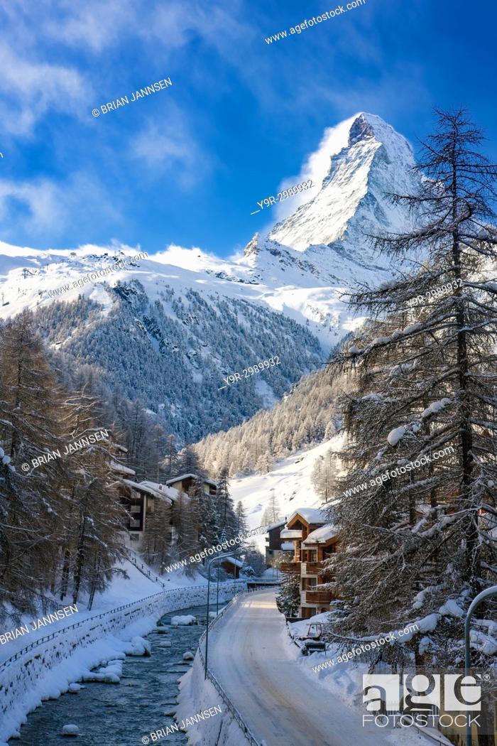 Stock Photo: The Vispa River flows below the peak of the Matterhorn through town of Zermatt in the Canton of Valais, Switzerland.