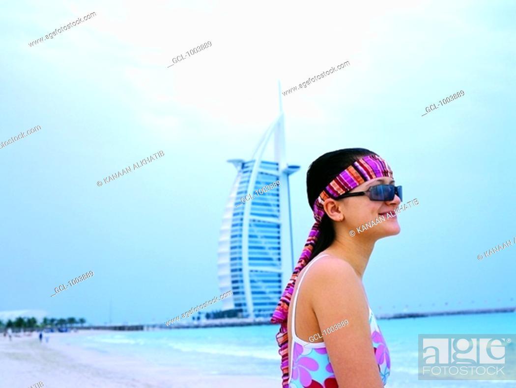 Stock Photo: Tourist on the beach near Burj Al Arab hotel in Dubai, UAE.