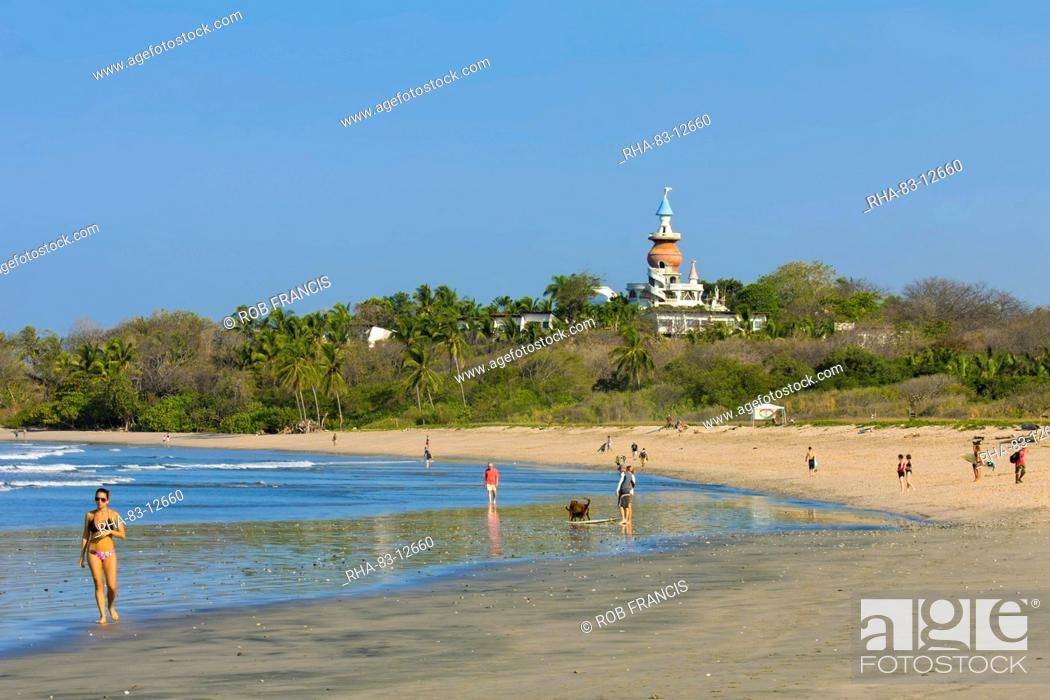 Stock Photo Walkers And The Nosara Beach Hotel At Por Playa Guiones Nicoya Peninsula Guanacaste Province Costa Rica Central America