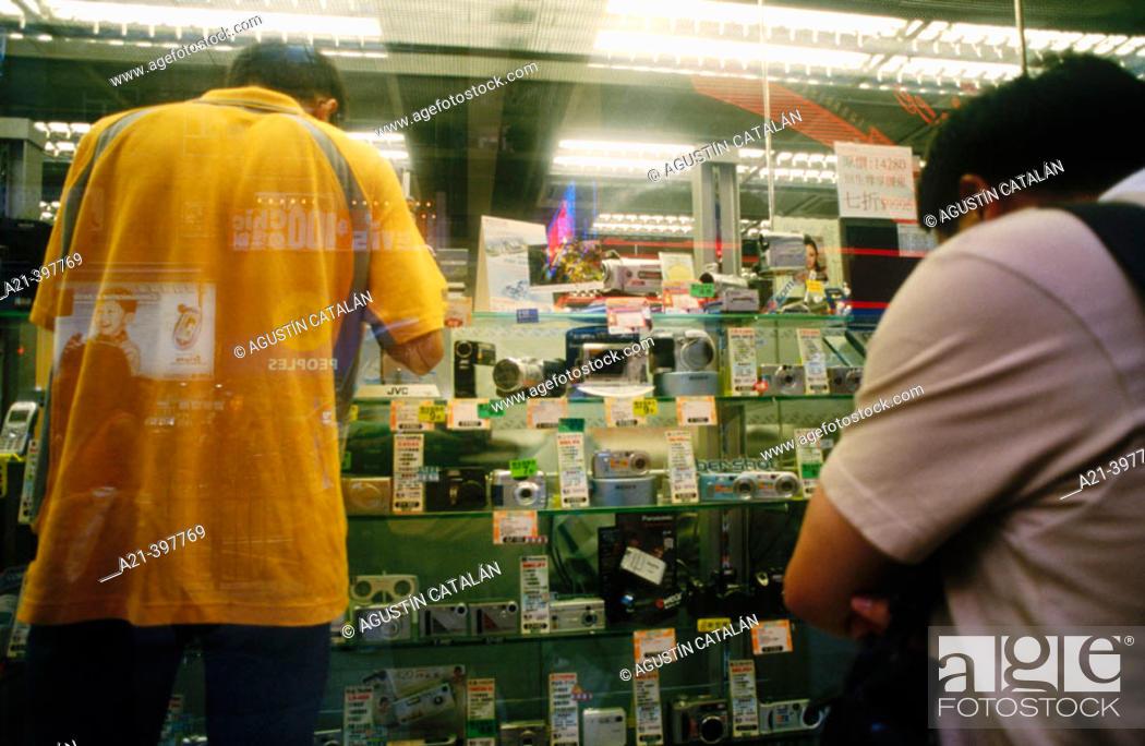 Stock Photo: Photographic material shop window. Hong Kong. China.