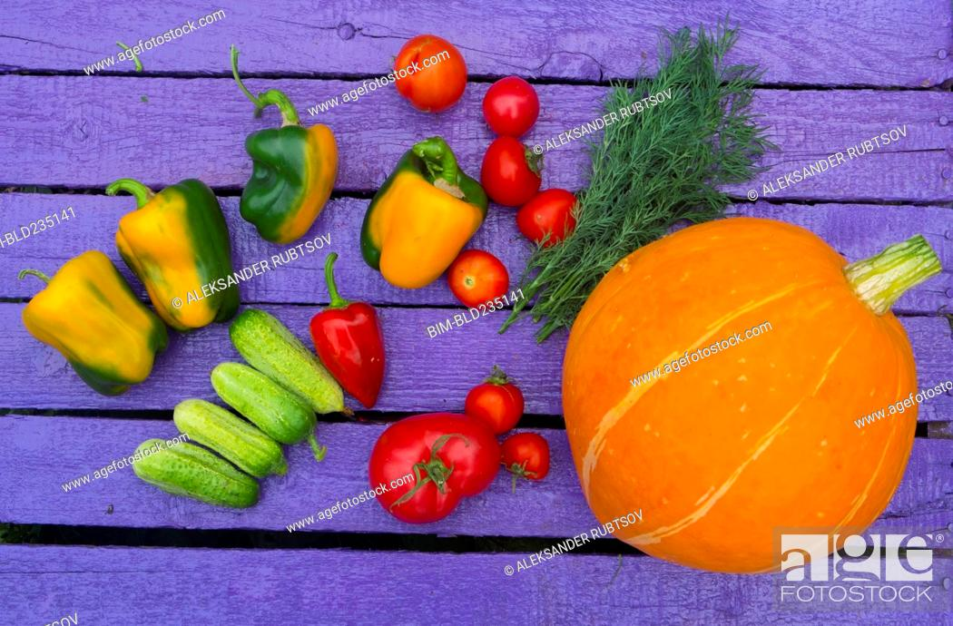 Stock Photo: Fresh vegetables on purple wooden table.