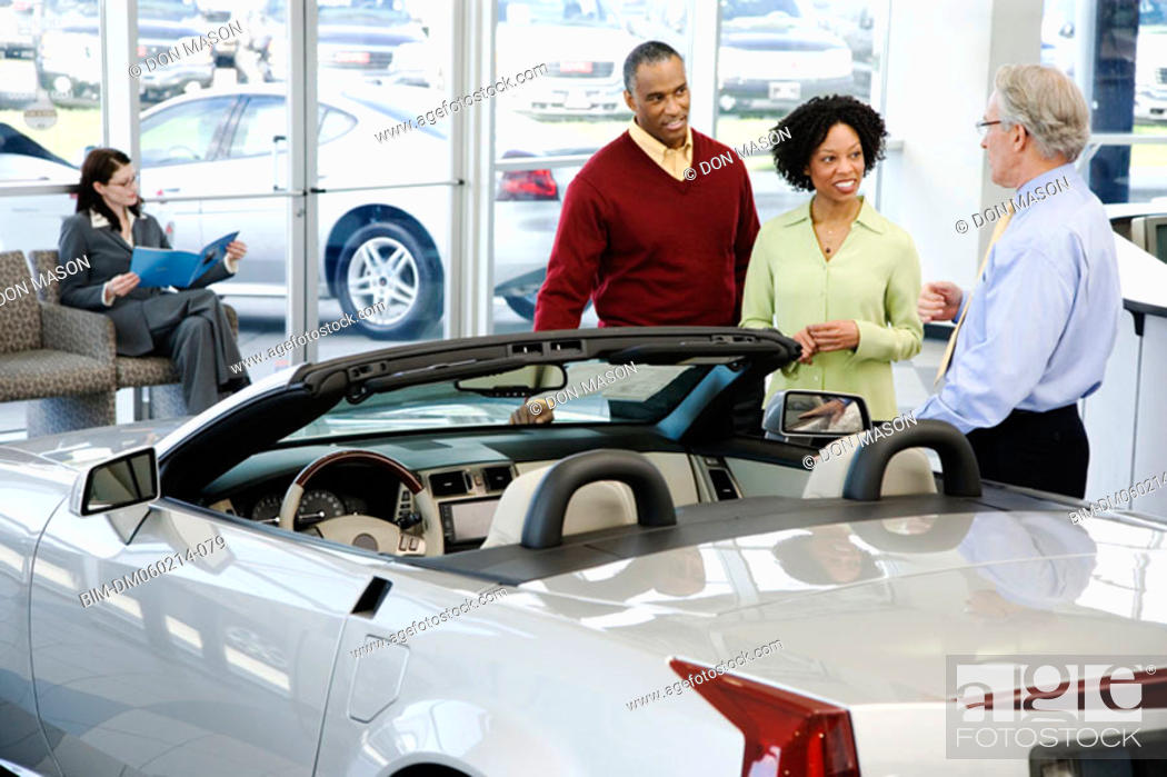 Stock Photo: Couple buying a car.